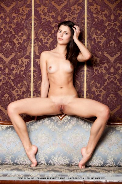 cute-brunette-jessie-takes-off-her-red-underwear-on-the-sofa_006