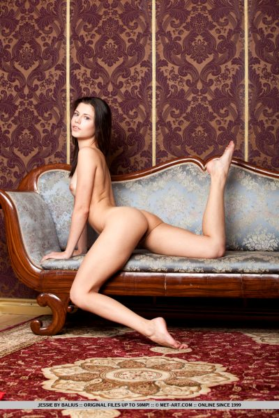 cute-brunette-jessie-takes-off-her-red-underwear-on-the-sofa_007